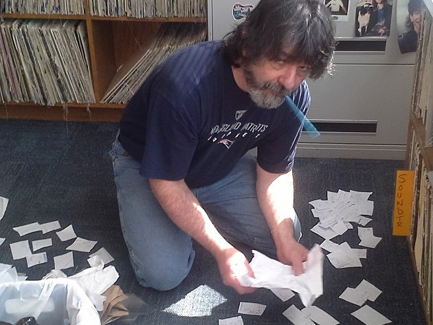 Tommy C arranges notes for the show