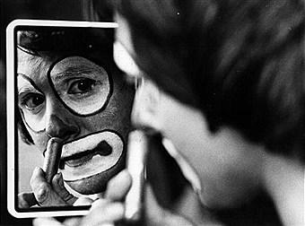 clown putting on makeup
