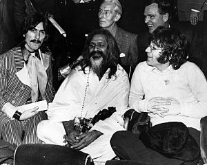 L-R: George, the Maharishi, John.